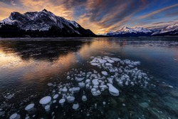 Sunrise with ice bubbles, Abraham Lake, Clearwater County, AB, Canada.
