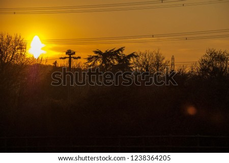 Sunrise with powerlines and trees #1238364205