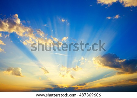 Sunrise with strong color clouds light rays and other atmospheric effects #487369606