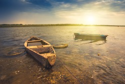 Sunrise with wooden boats on a river