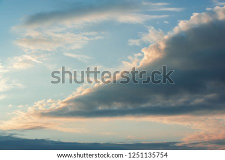 Sunrises  clouds. Cumulonimbus stones from Latin cumulus clouds, heaped up and nimbus, rainfall is a dense, towering vertical cloud formed from water vapor carried by powerful ascending air currents