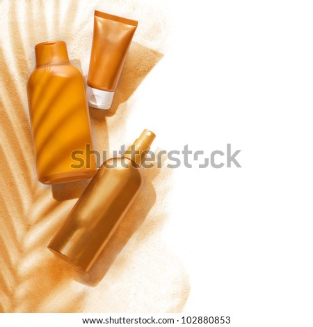 Sunscreen containers in a tropic ambiance on white background.
