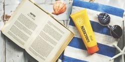 Sunscreen Sunglasses Towel Book Recess Relax Concept