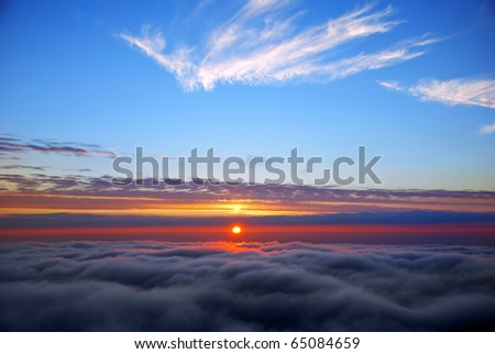 sunset above cloud line