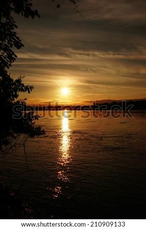 Sunset across the river in the Peruvian Amazon jungle, South America, Peru.
