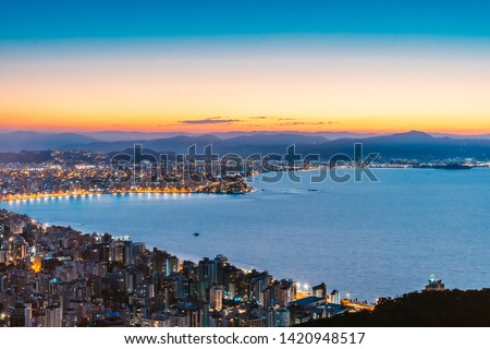 Sunset aerial view of sea shore in Florianopolis Brazil