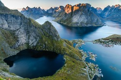 Sunset aerial view on stunning mountains and lakes of Lofoten islands, Norway