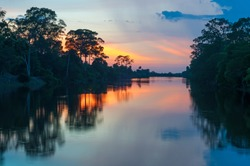Sunset along the banks of the Amazon river. The tributaries of the Amazon traverse the countries of Guyana, Ecuador, Peru, Brazil, Colombia, Venezuela, Suriname, French Guyana and Bolivia.