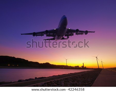 Sunset and airplane fly over river