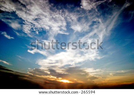 Sunset and blue sky with white clouds. Wide angle lens gives a sense of depth. Landscape format