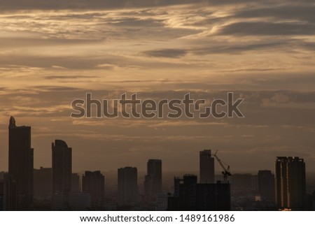 Sunset and city skyline filled with skyscrapers in Bangkok's business district. central business district concepts. #1489161986