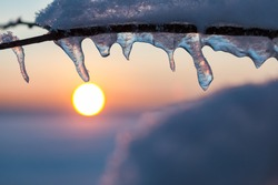 Sunset and icicles artistic abstract winter detail