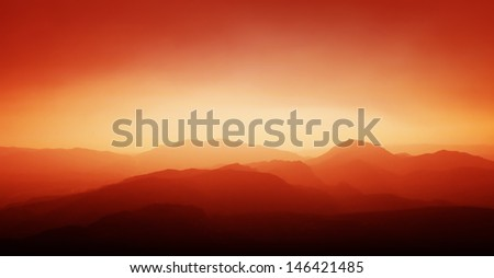 Sunset and mountain silhouette.