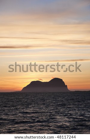 Sunset and mountain silhouette from the sea