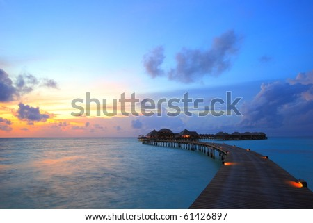 sunset and overwater villas stock photo