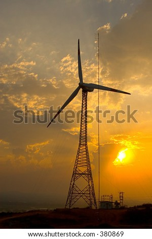 Sunset and power windmill