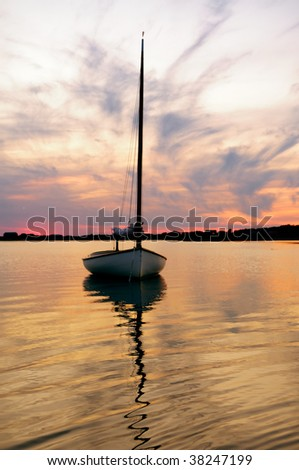 Sunset and sailboat in Martha's Vineyard, Massachusetts.