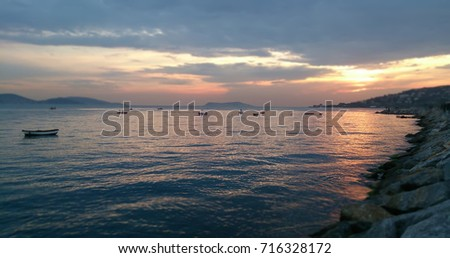 Sunset and sea view with boats