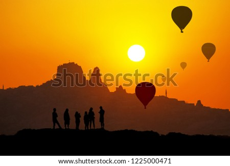 Sunset and silhouette of Uchisar Castle in Cappadocia Turkey #1225000471