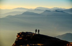 Sunset and Silhouettes during the trekking of Tungnath temple in India during winter