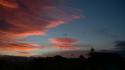 Sunset and sunrise with dramatic colorful clouds. Slovakia