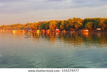 sunset and water house in river Sava, Belgrade, Serbia