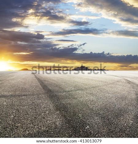 Sunset asphalt asphalt tire marks #413013079