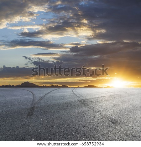 Sunset asphalt asphalt tire marks #658752934
