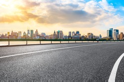 Sunset asphalt road and city skyline in Shanghai