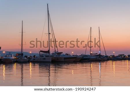 Sunset at a pier in Baska Voda in Croatia
