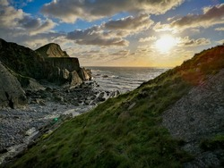 Sunset at a secluded cove. Hartland, North Devon, England.