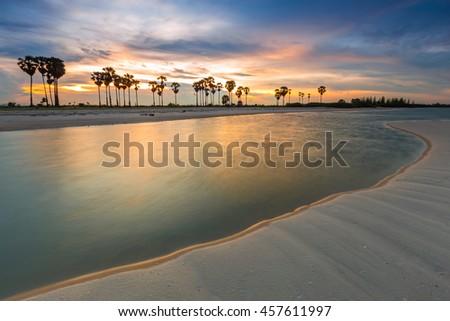Sunset at Bang kao village at Cha-am beach near the Huahin beach