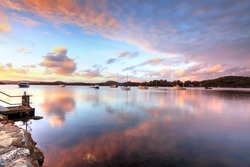 Sunset at Bensville Australia.   Boats and yachts and cloud reflections in the late afternoon.