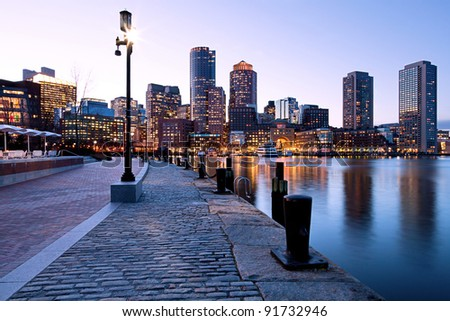 Sunset at Boston Harbor and Financial District in Boston, Massachusetts.
