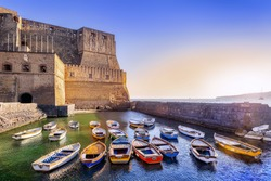 sunset at castel dell'ovo in napoli, italy