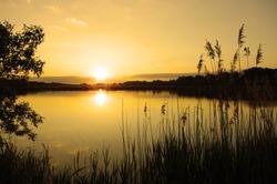 sunset at coast of the lake