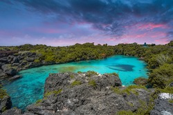 Sunset at Danau Weekuri in Sumba Island, Indonesia. Famous travel destinations.