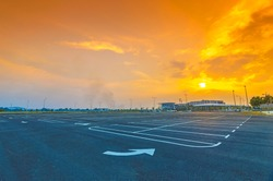 Sunset at empty parking lot