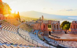 Sunset at Greek theater of Taormina, Sicily, Italy. Travel