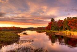 Sunset at Hamlet of Lake Pleasant in fall, Adirondack, NY.