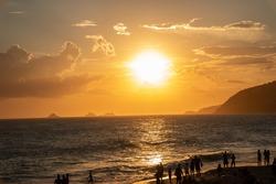 sunset at ipanema beach in rio de janeiro brazil.