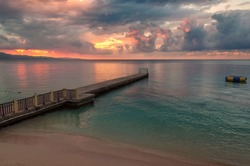 Sunset at Jamaica beach and pier in Montego bay.