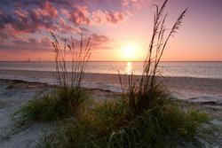 Sunset at Jekyll Island. Jekyll is located off the coast of the U.S. state of Georgia, in Glynn County. It is one of the Sea Islands and one of the Golden Isles of Georgia barrier islands.