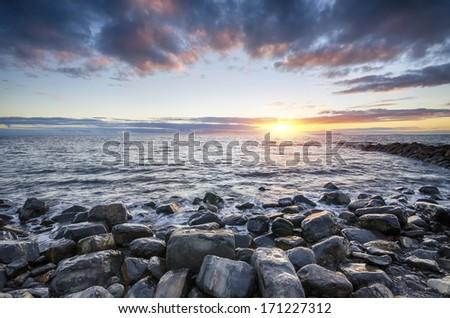 Sunset at Kimmeridge beach on the Jurassic Coast in Dorset - stock photo