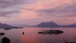 sunset at lago maggiore with pink sky