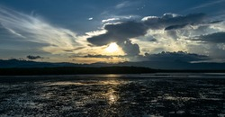 Sunset at load tide in Bais, Negros Oriental, Philippines