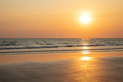 Sunset at Mae Ramphueng Beach.Low tide and wide beach at Rayong province,Thailand