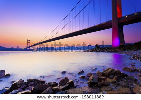Sunset at modern bridge along coast #158011889