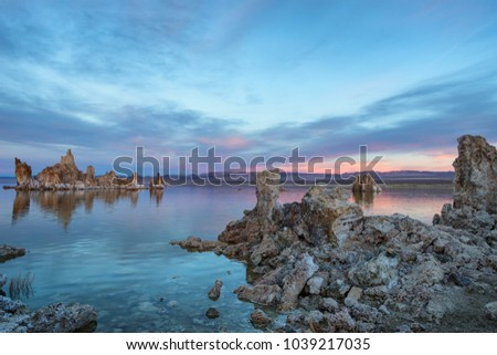 Sunset at Mono lake, California. Bizarre calcareous tufa formation on the smooth water of the lake. - Shutterstock ID 1039217035