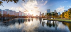 Sunset at Orlando in Lake Eola Park with water fountain and city skyline, Florida, USA